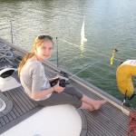 Anna on Evenstar Using Will's Remote Boat
